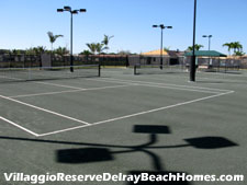 Lighted clay tennis courts at Delray Beach's Villaggio Reserve.